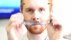 Closeup of serious man wearing eyeglass at work Stock Footage