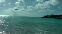 SAINT MAARTEN - Airplane landing above Maho beach in Princess Juliana airport Stock Footage