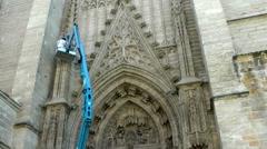 SEVILLE -  Sculpture restorer on Cathedral door Stock Footage
