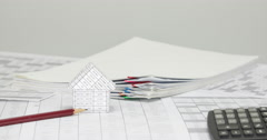 House and pencil with blur pile overload paper time lapse - stock footage