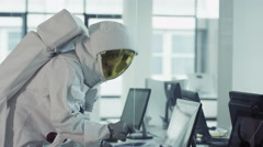4K Funny astronaut working in room full of computers & doing a little dance Stock Footage