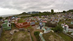 Buddhist cemetery overlooks highway from hillside in Nha Trang. UHD Stock Footage
