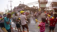 People splashing each other at Songkran Thai New Year celebration in, Thailan Stock Footage