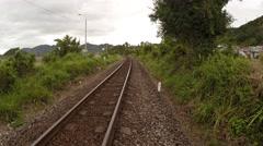 Walking alongside a railroad track near Nha Trang Stock Footage