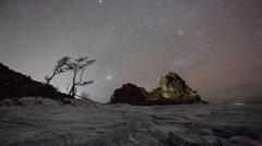 Starry night over the island Olkhon. Burkhan Cape, Olkhon island, Lake Baikal,  - stock footage
