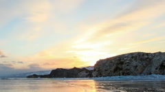 Sunset on the frozen Lake Baikal, Oltrek island. Irkutsk region, Russia. Full HD Stock Footage
