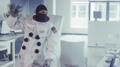 4K Funny astronaut in room full of computers dancing enthusiastically Stock Footage