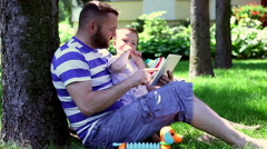 Father using tablet with son  Stock Footage