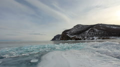 Movement of the clouds over the icy Lake Baikal on Olkhon Island, Lake Baikal,  Stock Footage