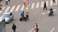 People do roadwork at the central square of the city in Xian, China. Stock Footage