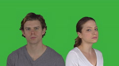 Sad couple turns and looks at camera (Green Key) Stock Footage