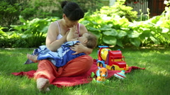 Mother feed baby  Stock Footage