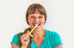 Young lady brushing teeth in the morning - dental hygiene Stock Photos