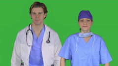 Professional medical couple with hands on hips (Green Key) - stock footage