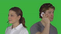Female customer service speaks with man (Green Key) Stock Footage