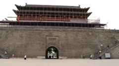 People walk by the square visiting the Great Wall in Xian, China. Stock Footage