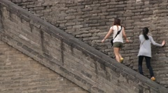 People move upstairs visiting the Great Wall in Xian, China. - stock footage
