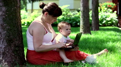 Mother using laptop with son  Stock Footage