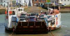 Chain ferry boat over a river connecting the two sides of the town of Cowes Stock Footage