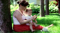 Mother using tablet with son Stock Footage