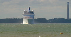 Ocean liner cruise ship with sailing boats maneuvering outside Southampton port  - stock footage