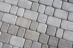 Stone paving texture. Abstract pavement background Stock Photos
