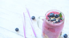 Blueberry smoothie with chia seeds, sesame and fresh berry Stock Footage