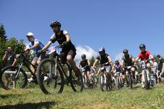 Mass bikers cycling in the mountain Stock Photos
