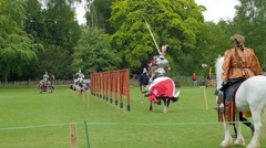 View of a medieval joust with knights in armour and costume - stock footage