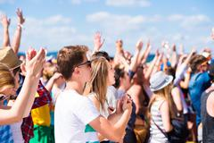 Teenagers at summer music festival having good time Stock Photos
