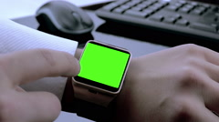business man using smartwatch app with chroma key green screen - stock footage
