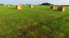 Flying fast and low through field of hay bales. Stock Footage