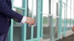 Close up of handshake greeting of two business partners, business centre Stock Footage