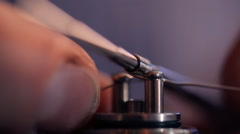 Installing winding on base of clearomizer, using coil jig, tightening of screws Stock Footage