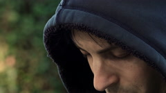 side portrait of a young depressed and painful man: sad young man  - stock footage