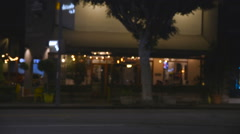 An upscale restaurant in Los Feliz. Cars drive by in front. Stock Footage