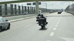 Two motorcyclists are driving on a highway Stock Footage