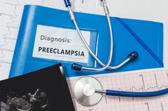 Preeclampsia diagnosis for pregnant patient with risky pregnancy. - stock photo