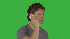 Man talking on phone with right hand (Green Key) - stock footage