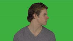 Sad man turns to camera (Green Key) Stock Footage