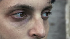 Sad and pensive young man: closeup footage on his eyes  Stock Footage