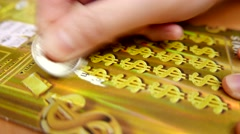 Close up woman scratching lottery ticket with 4k resolution - stock footage