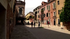 Venice Italy, people stroll the broad alleyways of beautiful Dorsoduro area. Stock Footage