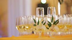 Decorated champagne flutes on table during wedding Stock Footage