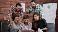 Colleagues rejoicing their work at business meeting. Slow motion Stock Footage