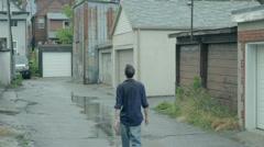 Wet man walks through puddles - stock footage