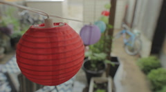 Patio lanterns rack focus to bike Stock Footage