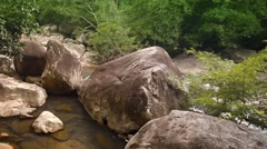 Babbling Brook Flowing around Boulders in Vietnam, with Sound Stock Footage