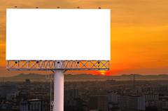 Blank billboard for advertisement with sunset in city Stock Photos