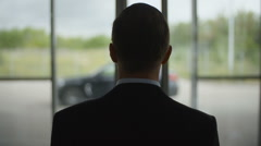 Businessman Walking To The Car Stock Footage